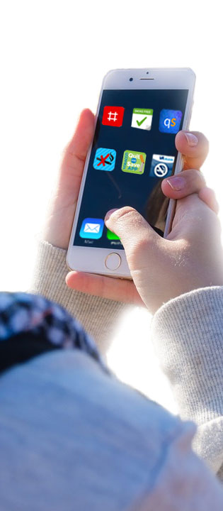 Person holding phone with apps displayed